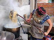 Master dyer Juana Gutierrez Contreras mordanting with cow tongue leaf in her natural dyes studio in the Zapotec weaving village of Teotitlan del Valle in Oaxaca, Mexico