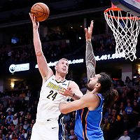 09 November 2017: Denver Nuggets center Mason Plumlee (24) goes for the baby hook over Oklahoma City Thunder center Steven Adams (12) during the Denver Nuggets 102-94 victory over the Oklahoma City Thunder, at the Pepsi Center, Denver, Colorado, USA.