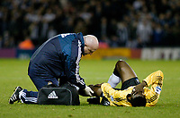 Fotball<br /> Premier League England 2004/2005<br /> Foto: SBI/Digitalsport<br /> NORWAY ONLY<br /> <br /> West Bromwich Albion v Newcastle United<br /> <br /> Newcastle's Shola Ameobi (R) writhes in pain after being brought down by Andy Johnson