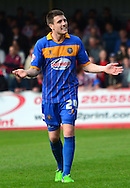 Bobby Grant encourages the fans during the Sky Bet League 2 match between Cheltenham Town and Shrewsbury Town at Whaddon Road, Cheltenham, England on 25 April 2015. Photo by Alan Franklin.