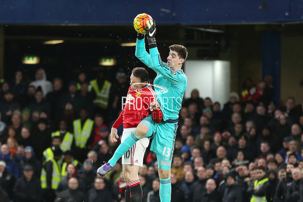 Chelsea's Goalkeeper Thibaut Courtois collects the ball from Wayne Rooney of Manchester United during the Barclays Premier League match between Chelsea and Manchester United at Stamford Bridge, London, England on 7 February 2016. Photo by Phil Duncan.