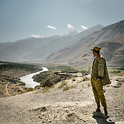 Tajik soldier manning the Afghan Tajik border.  The Pyanj river, also known as Amu Darya. The ancient Qaqa Fortress ruins near Namadgud village. <br /> Trekking between Namadgud village and Ishkashim town. Sights and places to see while walking along the Tajikistan side of the Wakhan Corridor.