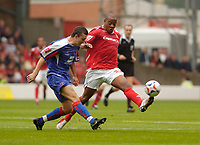 Photo: Leigh Quinnell.<br /> Nottingham Forest v Carlisle United. Coca Cola League 1. 16/09/2006. Forests Junior Agogo gets the ball away from Carlisles Paul Arnison.