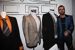 """© under license to London News Pictures. LONDON, 19/05/2011. Beatle Ringo Starr next to some suits he loaned to the exhibition. Opening of the Tommy Nutter Exhibition """"Rebel on the Row"""" at the Fashion and Textile Museum, London. Photo credit should read BETTINA STRENSKE/LNP"""