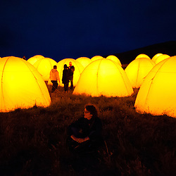 Cemaes Bay, Anglesey, UK. 19th July 2012. As part of the Cultural Olympiad, Artichoke collaborated with Fiona Shaw to produce 8 peace camps around the UK. Glowing beacons of peace speaking poetry from dusk till dawn.