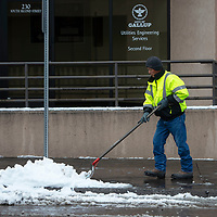 Norman Gray, a municipal maintenance employee with the city of Gallup clears the sidewalks on 2nd Street in Gallup Wednesday morning.