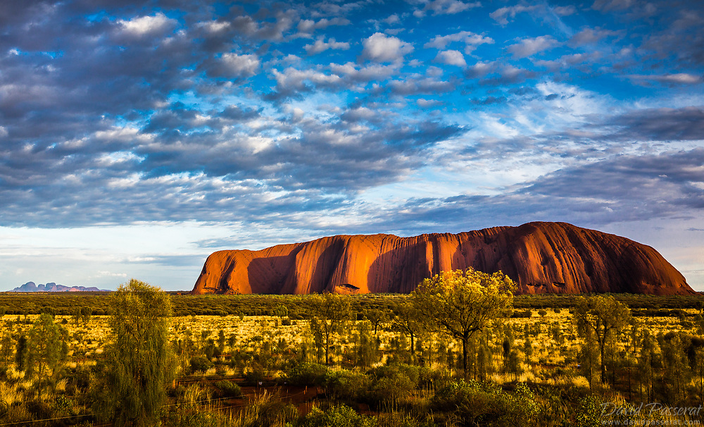 Sunrise caresses the southern flanks of Uluru's mythical rock. A sacred rock, a sacred moment.