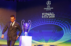 December 12, 2017 - Kiev, Ukraine - Ambassador of Champions League final and former Ukrainian soccer player ANDRIY SHEVCHENKO walks in front the Champions League trophy and the logo of the 2018 UEFA Champions League final, during the presentation of the logo of the 2018 UEFA Champions League final in Kiev, Ukraine, on 12 December 2017. The UEFA Champions League final will be played at the Olimpiyskiy stadium in Kiev on 26 May 2018. (Credit Image: © Serg Glovny via ZUMA Wire)
