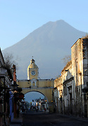Volcan de Agua, the Volcano of Water, 3766m, dominates views to the south of Antigua Guatemala. Here it is the background to 5 Avenida Sur and Arco de Santa Catalina, the Santa Catalina Arch. Antigua Guatemala, Republic of Guatemala. 02Mar14