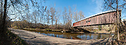 Cox Ford Covered Bridge was built in 1913 in Burr Arch style by J.A. Britton over Sugar Creek. A roof and red painted wood sides protect this historic bridge in Turkey Run State Park, in historic Parke County, Indiana, USA. Panorama stitched from 12 photos.