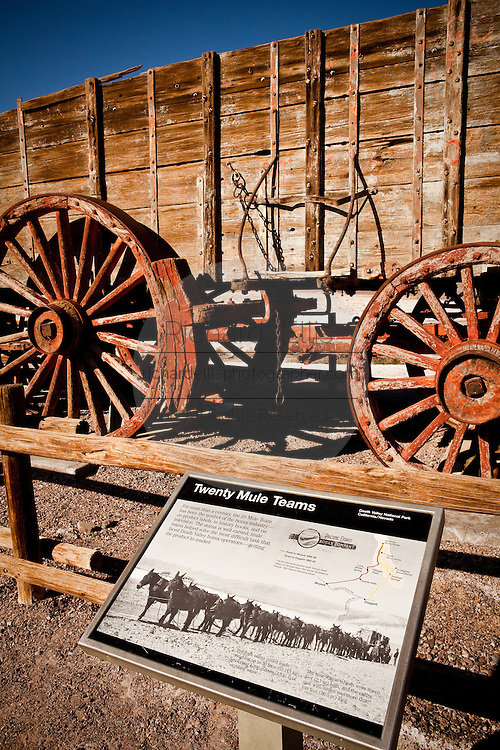 Original twenty mule team wagon used to carry borax out of the mines on display at Sign at Death Valley National Park, California, USA.