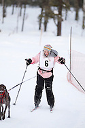 Photo Randy Vanderveen.Grande Prairie , Alberta.13-01-05.Billie Smith urges her dog through the race course as she takes part in the skijor event ? dogs pull the musher around the course on skis as opposed to a sled. The Grande Prairie Sled Dog Derby ran two days of races at Evergreen Park this past weekend, Jan. 5 and 6.