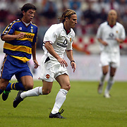 Manchester United's Diego Forlan gets away from Parma's Simone Barone