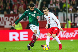 November 13, 2017 - Gdansk, Poland - Krzysztof Maczynski (POL) vies Oribe Peralta (MEX) during the International Friendly match between Poland and Mexico at Energa Stadium in Gdansk, Poland on November 13, 2017. (Credit Image: © Foto Olimpik/NurPhoto via ZUMA Press)