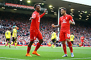 Daniel Sturridge of Liverpool (l)celebrates with his teammate Danny Ings after scoring his teams 2nd goal. Barclays Premier League match, Liverpool v Aston Villa at the Anfield stadium in Liverpool, Merseyside on Saturday 26th September 2015.<br /> pic by Chris Stading, Andrew Orchard sports photography.