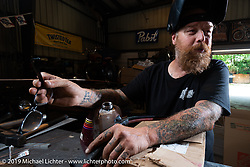 Bill Dodge welding a gas tank for his Skin and Bones / Chop-Off bike in his Daytona Beach shop. FL, USA. Monday May 16, 2016.  Photography ©2016 Michael Lichter.