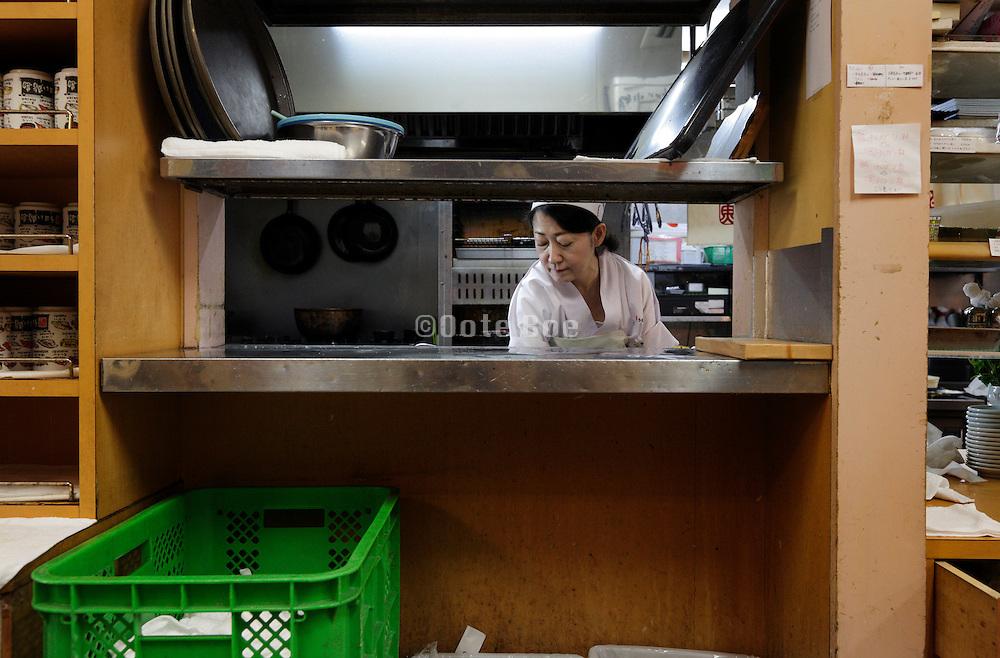 dishes cleaning counter inside sushi restaurant at Tsukiji fish market Tokyo, Japan.