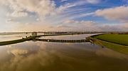 Nederland, Gelderland, Gemeente Arnhem, 04-002-2021; Hondsbroeksche Pleij met in de achtergrond de IJsselkop (splitsing van het Pannerdensch Kanaal in Neder-Rijn en IJssel). In de uiterwaarden van de Hondsbroeksche Pleij bij Westervoort het regelwerk wat bij hoogwater het water over beide riviertakken verdeelt. Het hoogwater komt via de Rijn vanuit Duitsland ten gevolge van overvloedige regenval en smeltwater bij de bovenloop van de rivier de Rijn. <br /> Hondsbroeksche Pleij with the IJsselkop in the background (where the Pannerdensch Canal of the Rhine bifurcates in the rivers in Neder-Rijn and IJssel). In the floodplains of the Hondsbroeksche Pleij near Westervoort, the regulating work that divides the water over both river branches during high water. The high water comes from Germany via the Rhine as a result of abundant rainfall and meltwater at the upper reaches of the river Rhine.<br /> <br /> drone-opname (luchtopname, toeslag op standaard tarieven);<br /> drone recording (aerial, additional fee required);<br /> copyright foto/photo Siebe Swart