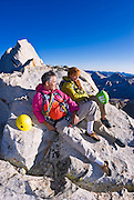 Climbers on the summit of Bear Creek Spire, John Muir Wilderness, Sierra Nevada Mountains, California