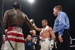 Billy Joe Saunders (right) and his son shake hands with Willie Monroe Jnr after the WBO World Middleweight Championship bout at the Copper Box Arena, London.
