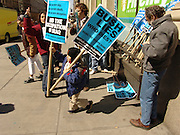 Protestors taking a protest sign New York City No War on Iraq Protest March 22 2004