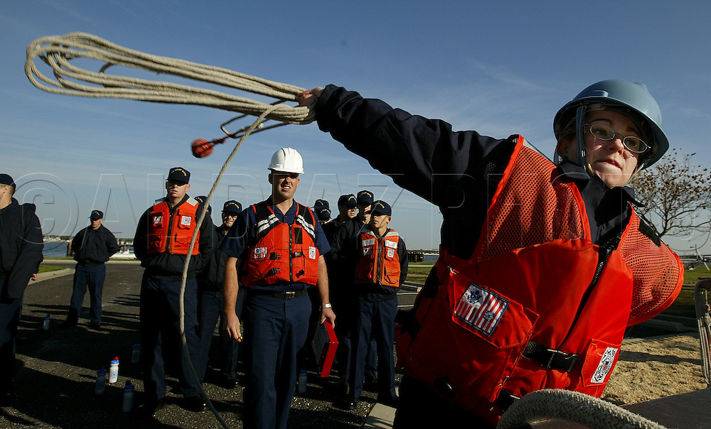 Seaman Recruit Michelle Holzer, throws a heaving line during practical seamanship class during Boot Camp at The United States Coast Guard Training Center Cape May, NJ.