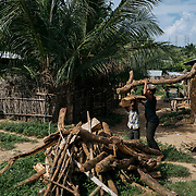 A mom  carries firewood with her son. Abume, E/R. Ghana. Child Labour is endemic in fishing communities across Ghana.