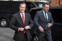 © Licensed to London News Pictures. 18/04/2019. London, UK. Brexit Party leader NIGEL FARAGE is seen flanked by security as he arrives at Milbank studios in Westminster ahead of a television appearance. The newly formed Brexit Party has taken a sudden surge in polls ahead of upcoming European elections in May.  Photo credit: Ben Cawthra/LNP