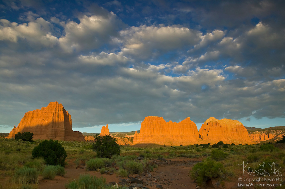 Sevaral prominent monoliths in the Cathedral Valley of Capitol Reef National Park, Utah, are turned dramatic shades of red at sunrise. The large monolith at the left of the image is the Temple of the Sun.
