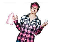 Portrait of a unhappy woman holding detergent in studio on white isolated background