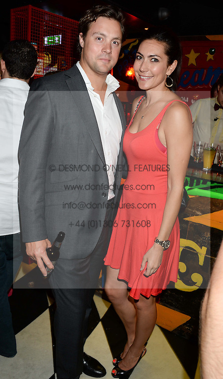 LOUISE COLE and JAMES NEWSON at a party to celebrate the launch of Charlie Gilkes and Duncan Stirling's new nightclub 'Disco' at 13 Kingly Court, London on 26th June 2013.