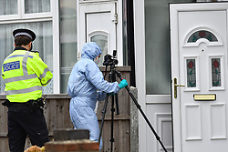 ©Licensed to London News Pictures; 06/10/2020, London UK; Met Police forensic officers search for evidence at an investigation in Reede road, Dagenham, East London after shots were fired at around 4 am this morning. Two people a male & female in their thirties were rushed to hospital: Photo credit, Steve Poston/LNP