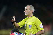 Referee Martin Atkinson seeks attention for Victor Moses of Stoke City - Football - Barclays Premier League - Stoke City vs Burnley - Britannia Stadium Stoke - Season 2014/2015 - 22nd November 2015 - Photo Malcolm Couzens /Sportimage