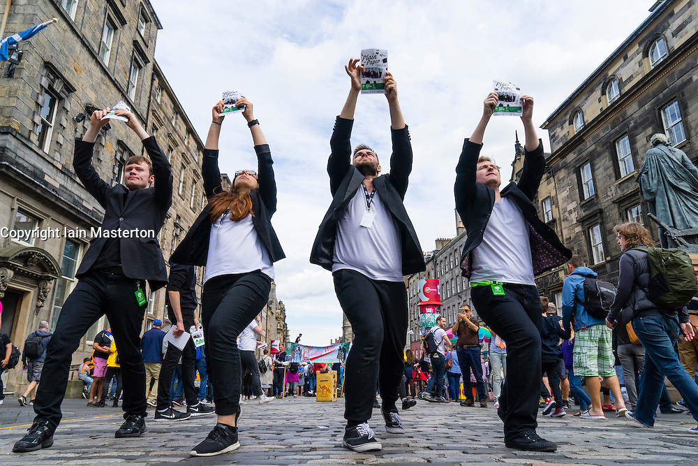 """Actors from GLT Theatre Group promoting production """"Plain as Paper"""" on  High Street during Edinburgh Fringe Festival 2016 in Scotland , United Kingdom"""