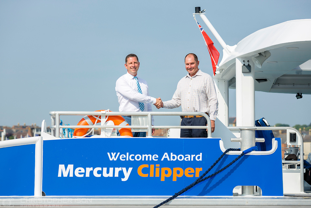 IMAGE PROVIDED FREE FOR EDITORIAL USE<br /> Sean Collins, CEO and co-founder of MBNA Thames Clippers (left) and Roy Whitewood, Senior Consultant at the Wight Shipyard Company pictured on board the newest addition to London's river bus transport network, Mercury Clipper, in East Cowes today as the vessel begins a 200 nautical mile maiden journey to the Capital from the Isle of Wight. Joining the MBNA Thames Clippers fleet, Mercury Clipper, is the first of two new boats that will enter service in London this summer. Six members of crew – with over 80 years of combined experience between them – will carry out the 12 hour journey, at an average speed of 20 knots. <br />  <br /> A £6.3 million investment in London's port and transport infrastructure, Mercury Clipper and Jupiter Clipper have been built at the Wight Shipyard Co Ltd on the Isle of Wight. The boats took 10 months to build, creating over 75 new jobs across the Isle of Wight and London, including the hiring of two dedicated apprentices and engagement with over 100 local suppliers from across the South of England.<br />  <br /> For more information, please visit www.mbnathamesclippers.com<br /> Picture date: Wednesday June 21, 2017.<br /> Photograph by Christopher Ison ©<br /> 07544044177<br /> chris@christopherison.com<br /> www.christopherison.com