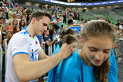 Jani Kovacic of Slovenia and a fan after volleyball match between National teams of Slovenia and Belgium in 2nd Round of 2018 FIVB Volleyball Men's World Championship qualification, on May 28, 2017 in Arena Stozice, Ljubljana, Slovenia. Photo by Morgan Kristan / Sportida