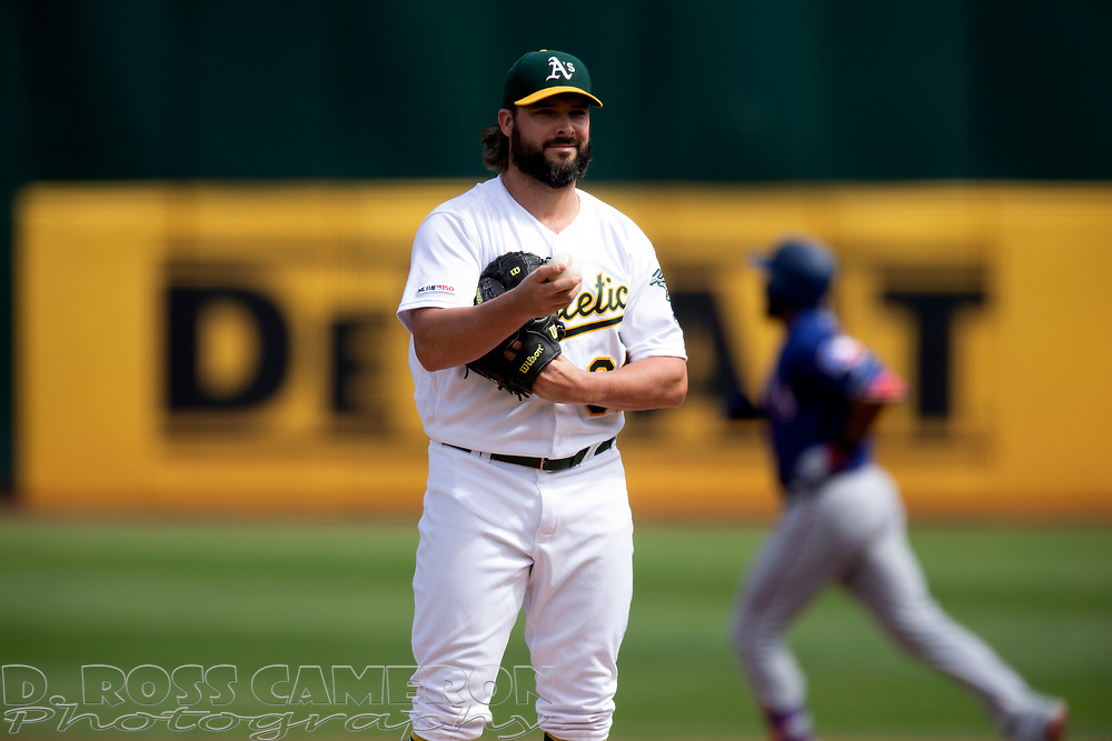 Oakland Athletics starting pitcher Tanner Roark (60) waits while Texas Rangers' Elvis Andrus runs out his two-run home run during the first inning of a baseball game, Sunday, Sept. 22, 2019, in Oakland, Calif. (AP Photo/D. Ross Cameron)