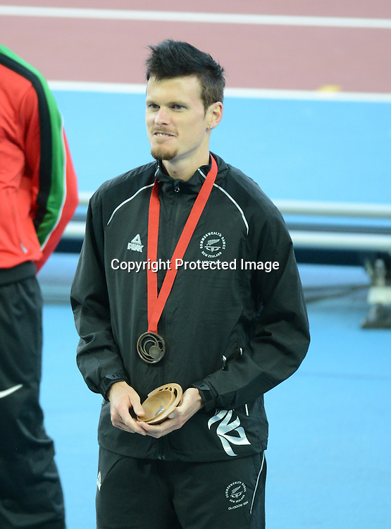 Zane Robertson of New Zealand receives his bronze medal in the Commonwealth Games  men's 5000m on Sunday July 28th 2014