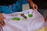 One of the tea towels that has been painted by one of the mothers at the community library, Biblioteca Comunitaria do Arquipelago, Porte Alegre, Brazil. <br /> <br /> Cirandar is working in partnership with  C&A and C&A Instituto to implement a network of Community Libraries in eight communities of Porto Alegre.