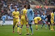 Bristol Rovers defender Tony Craig (5) squares up to Coventry City striker Amadou Bakayoko (21) during the EFL Sky Bet League 1 match between Coventry City and Bristol Rovers at the Ricoh Arena, Coventry, England on 7 April 2019.