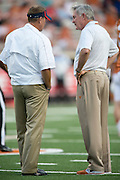 AUSTIN, TX - SEPTEMBER 14: Head coach Mack Brown of the Texas Longhorns (right) speaks with head coach Hugh Freeze of the Mississippi Rebels before kickoff on September 14, 2013 at Darrell K Royal-Texas Memorial Stadium in Austin, Texas.  (Photo by Cooper Neill/Getty Images) *** Local Caption *** Mack Brown; Hugh Freeze