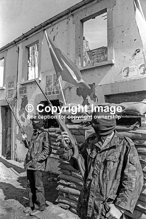 Provisional IRA members have set up a sandbag emplacement and checkpoint to regulate foot and vehicle traffic into and out of Free Derry, essentially the Bogside area of Londonderry. May 1972. 197205000294e<br /> <br /> Copyright Image from Victor Patterson, Belfast, UK<br /> <br /> t: +44 28 9066 1296 (from Rep of Ireland 048 9066 1296)<br /> m: +44 7802 353836<br /> e: victorpattersonbelfast@gmail.com<br /> <br /> www.images4media.com<br /> <br /> Please see my full Terms and Conditions of Use at https://www.images4media.com/p/terms-conditions - it is IMPORTANT that you familiarise yourself with them.<br /> <br /> Images used online incur an additional cost. This cost should be agreed in writing in advance. Online images must be visibly watermarked i.e. © Victor Patterson or that of the named photographer within the body of the image. The original metadata must not be deleted from images used online.<br /> <br /> This image is only available for the use of the download recipient i.e. television station, newspaper, magazine, book publisher, etc, and must not be passed on to a third party. It is also downloaded on condition that each and every usage is notified within 7 days to victorpattersonbelfast@gmail.com.<br /> <br /> The right of Victor Patterson (or the named photographer) to be identified as the author is asserted in accordance with The Copyright Designs And Patents Act (1988). All moral rights are asserted.
