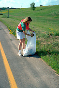 Youth worker 17 cleaning up adopted section of highway.  St Joseph Minnesota USA