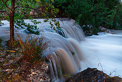 Waterfall flowing into Block Creek at dusk, swollen by recent rains, Block Creek Natural Area, Hill Country, Texas, USA
