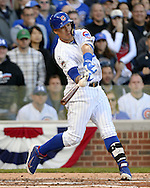 CHICAGO, IL - OCTOBER 12:  Javier Baez #5 of the Chicago Cubs hits a three-run home run off of John Lackey #41 of the St. Louis Cardinals in the second inning during Game 3 of the NLDS against the St. Louis Cardinals at Wrigley Field on Monday, October 12, 2015 in Chicago , Illinois. (Photo by Ron Vesely/MLB Photos via Getty Images) *** Local Caption *** Javier Baez; John Lackey