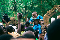 LAGOS, Aug. 26, 2013  A child is raised over heads of worshippers during the Osun Osogbo festival, or the river goddess festival, in Osogbo, capital of southwest Nigeria's Osun State, on Aug. 23, 2013. Every August in Osogbo, the festival presents an opportunity for the indigenes of Osogbo, their friends and well-wishers as well as fun-loving tourists to converge in town for the yearly celebration. The festival has gained a global recognition to such an extent that the Osun Grove was enlisted as a world heritage site in 2005.   (Xinhua/Zhang Weiyi) (Credit Image: © Xinhua via ZUMA Wire)