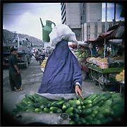 A woman wearing a burqa shops alone in Kabul's bazaar.