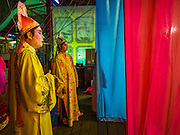 "06 DECEMBER 2015 - BANGKOK, THAILAND: Chinese opera performers wait in the wings before taking the stage at the Ruby Goddess Shrine in the Dusit district of Bangkok. Chinese opera was once very popular in Thailand, where it is called ""Ngiew."" It is usually performed in the Teochew language. Millions of Chinese emigrated to Thailand (then Siam) in the 18th and 19th centuries and brought their culture with them. Recently the popularity of ngiew has faded as people turn to performances of opera on DVD or movies. There are about 30 Chinese opera troupes left in Bangkok and its environs. They are especially busy during Chinese New Year and Chinese holidays when they travel from Chinese temple to Chinese temple performing on stages they put up in streets near the temple, sometimes sleeping on hammocks they sling under their stage.     PHOTO BY JACK KURTZ"