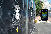 Ozzy Osbourne neaxt to HM Government and NHS advertising boards advice to stay alert to the symptoms as the Coronavirus lockdown continues, the city centre is still very quiet while more traffic and people are returning, and with restrictions due to be relaxed further in the coming days, the quiet city may be coming to an end as businesses are set to start to reopen soon on 27th May 2020 in Birmingham, England, United Kingdom. Coronavirus or Covid-19 is a respiratory illness that has not previously been seen in humans. While much or Europe has been placed into lockdown, the UK government has put in place more stringent rules as part of their long term strategy, and in particular social distancing.