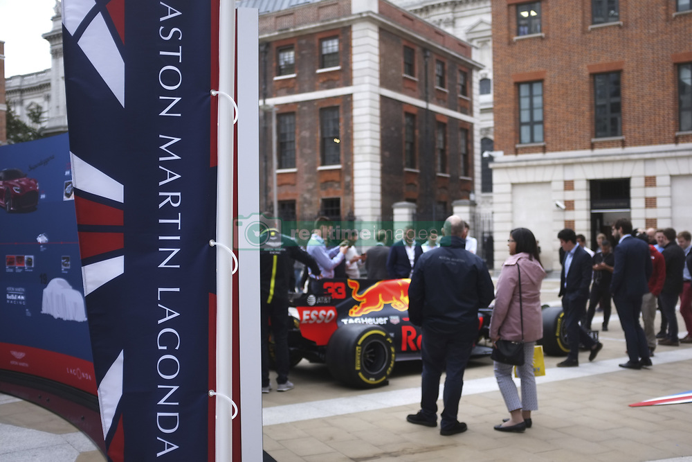 October 3, 2018 - London, England, United Kingdom - People gather to take pictures and see Aston Martin racing and tourism car parked outside the London Stock Exchange on the day of the trading debut of Aston Martin Lagonda Global Holdings Plc at the London Stock Exchange in London, on October 3, 2018. (Credit Image: © Alberto Pezzali/NurPhoto/ZUMA Press)